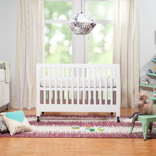 Babyletto Maki Portable Foldable Full-Size modern crib in White with Spruce Tree bookcase, lemonade playset, and Hudson Changer