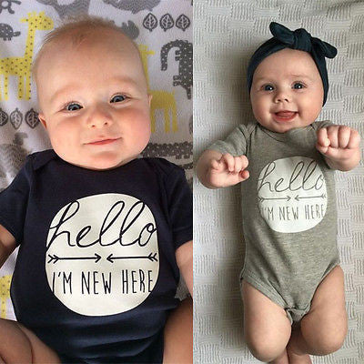 """Hello I'm here"" baby playsuit"