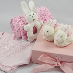 Pink baby girl gift box with knitted romper with bunny booties and knitted bunny rattle