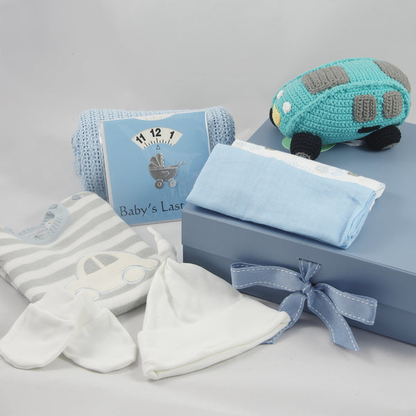Car Theme baby boy gift box with crocheted car rattle, knotted hat, and blue cellular blanket