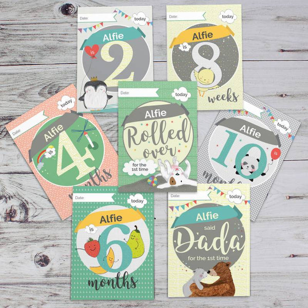 baby milestone cards on grey background