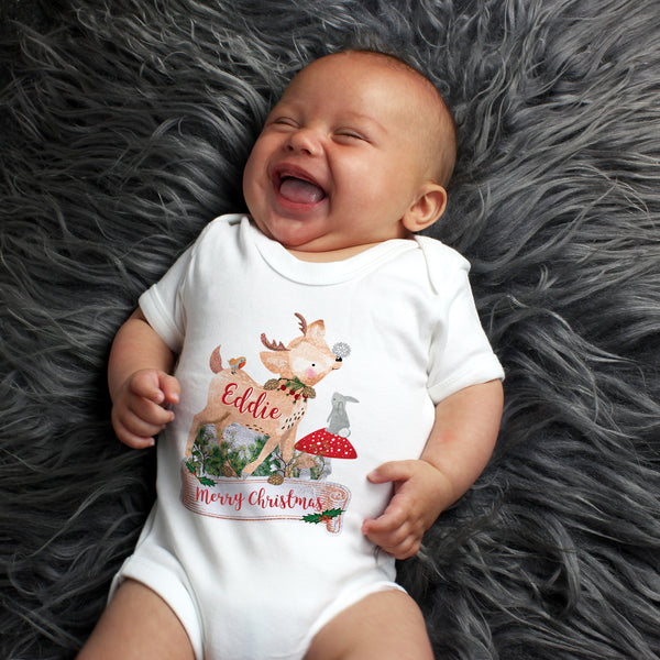smiling baby wearing personalised fawn bodysuit
