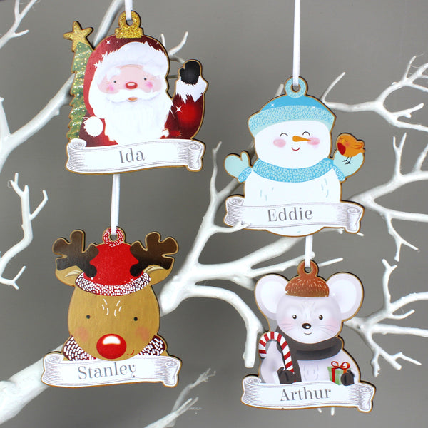 Set of four wooden hanging decorations: a Santa Claus, snowman, mouse, and reindeer.
