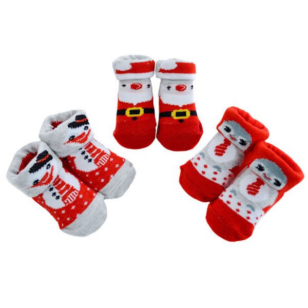Baby's first Christmas socks in 0 - 6 months, three designs Santa, Penguin, Snowman