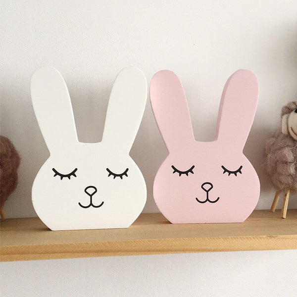 white bunny and pink bunny nursery decor on shelf, nursery accessories