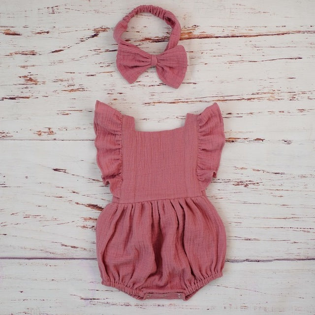 pink romper with matching headband for baby girls