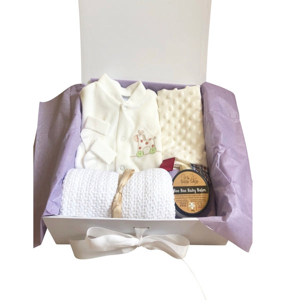 unisex baby gift box, handmade soap, baby boo boo balm, velour sleep suit, unisex baby clothes