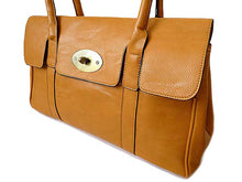 MUSTARD YELLOW LEATHER EFFECT CLASSIC HANDBAG WITH TWIST-LOCK CLOSURE