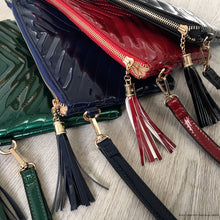 RED PATENT TASSEL CLUTCH BAG WITH LONG CROSS BODY SHOULDER STRAP