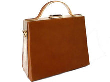 TAN HARDBACK METAL HOLDALL HANDBAG WITH LONG STRAP