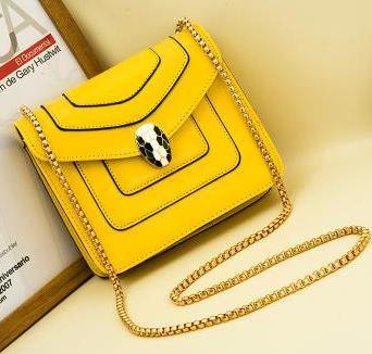 YELLOW EMBELLISHED CLASP CROSS-BODY BAG WITH LONG CHAIN STRAP