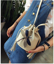 SMALL CREAM DRAWSTRING CROSS-BODY BAG WITH EMBELLISHED DRAGON FLY