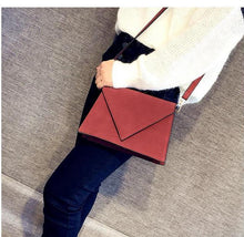 RED STRUCTURED ENVELOPE HOLDALL HANDBAG WITH LONG STRAP