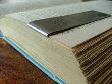 A dirty book is rarely dusty. - Custom Hand Stamped Aluminum Fold-Over Bookmark by MyBella