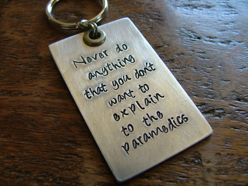 Never do anything that you don't want to explain to the paramedics. - Custom hand stamped keychain by MyBella