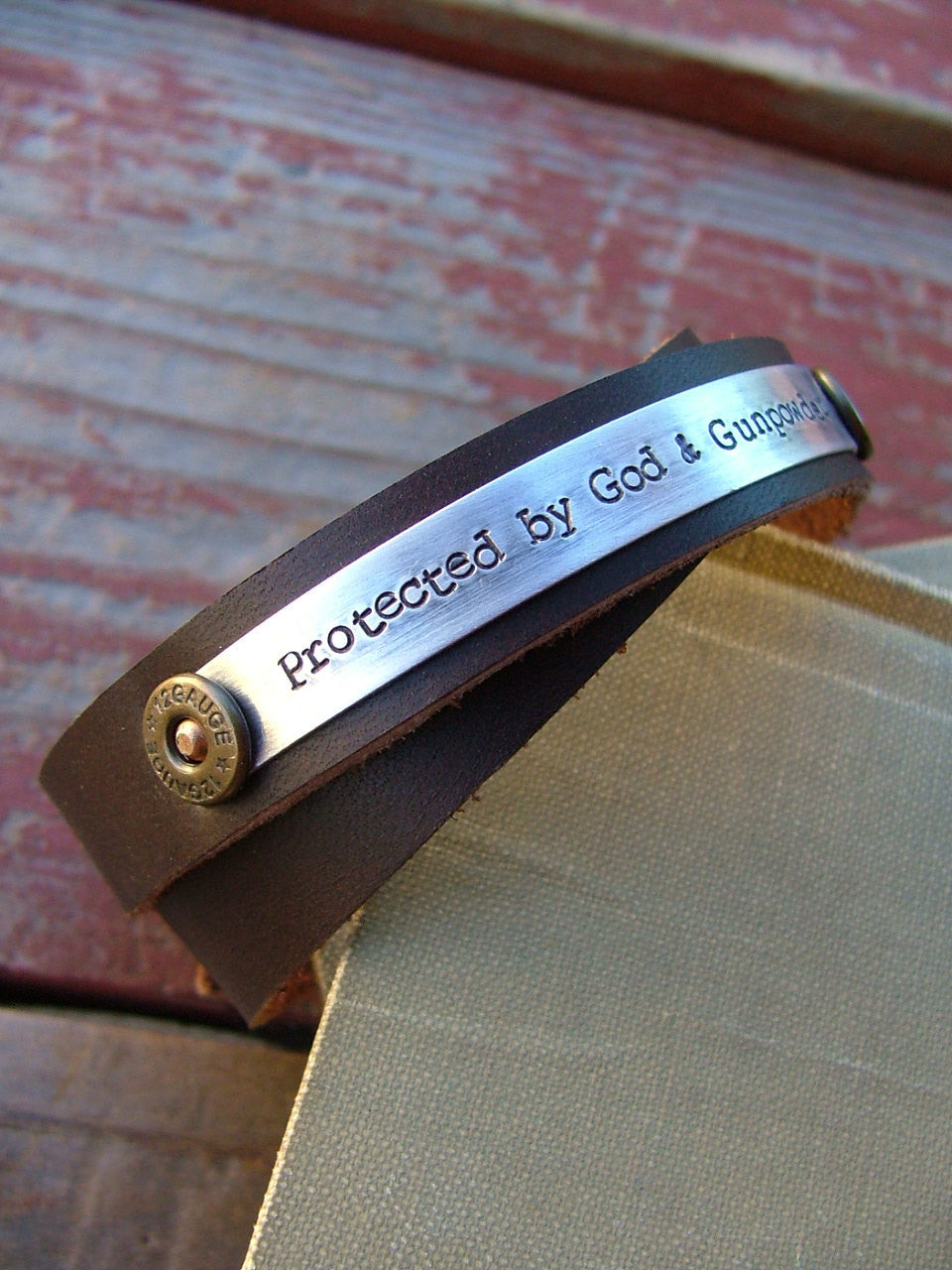 Protected By God & Gunpowder 12 Gauge Round 1/2 Inch Double Strand Leather Cuff Bracelet with Custom Hand Stamped Metal by MyBella