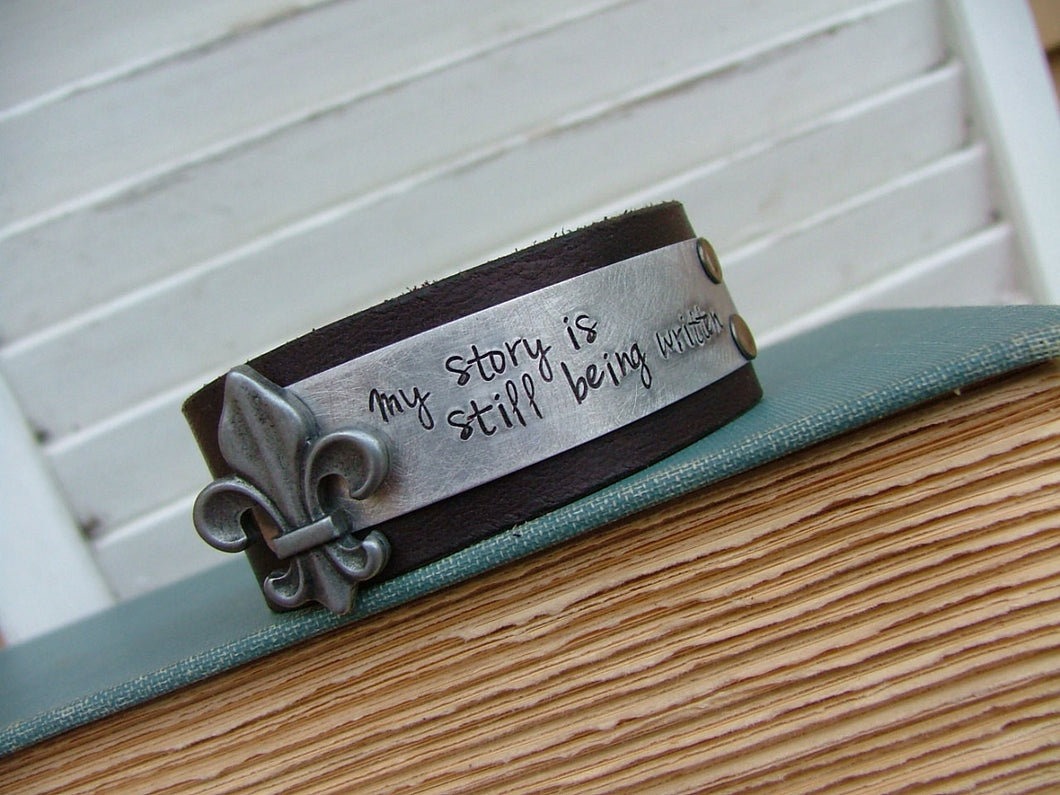 My Story Is Still Being Written Fleur de Lis Custom Cut 1 Inch Tall Leather Cuff with Custom Hand Stamped Metal by MyBella
