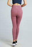 A raspberry pink yoga gym tights produced by HOLABOLLA activewear.