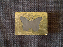 Nickel butterfly brass badge