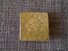 Raised clenched fist resistance brass badge