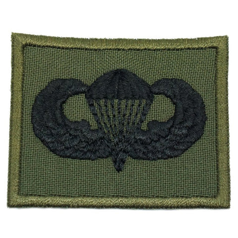 US PARACHUTIST BADGE - OD GREEN BORDER
