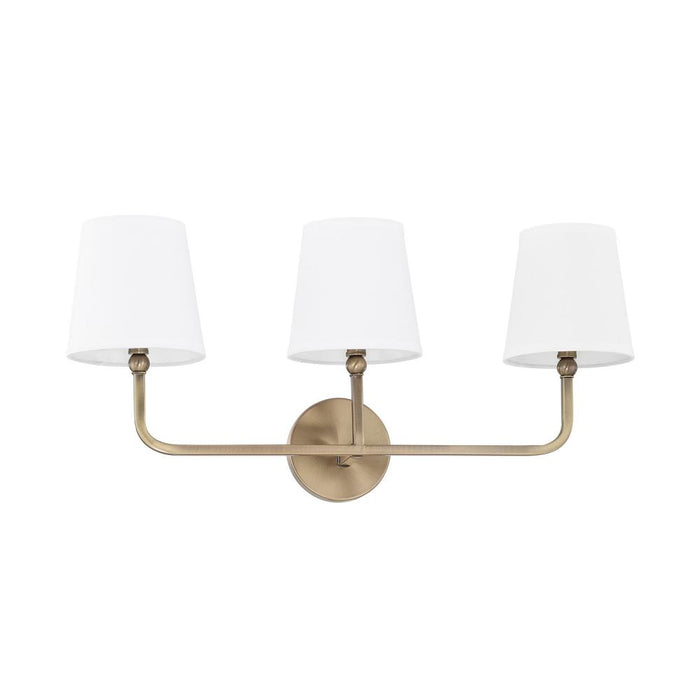 an image of Capital Lighting Dawson 3 Light Vanity in Aged Brass