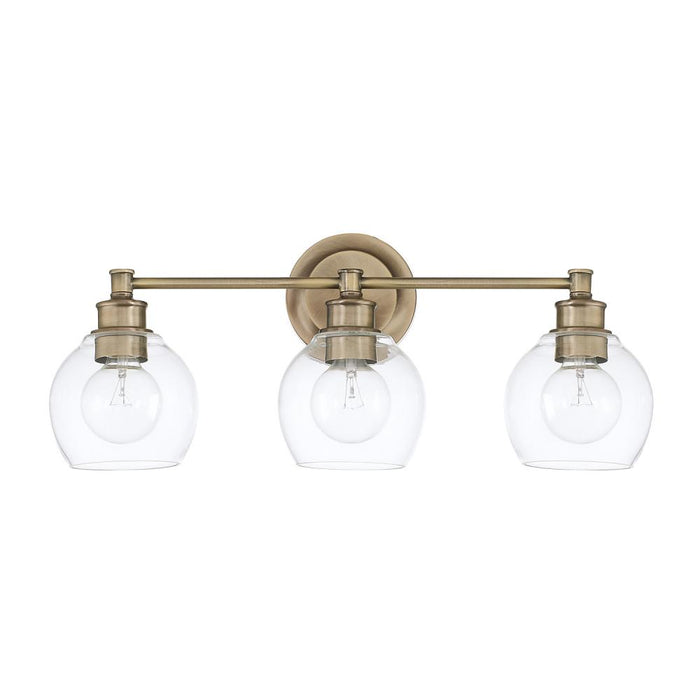 an image of Capital Lighting Mid Century 3 Light Vanity in Aged Brass