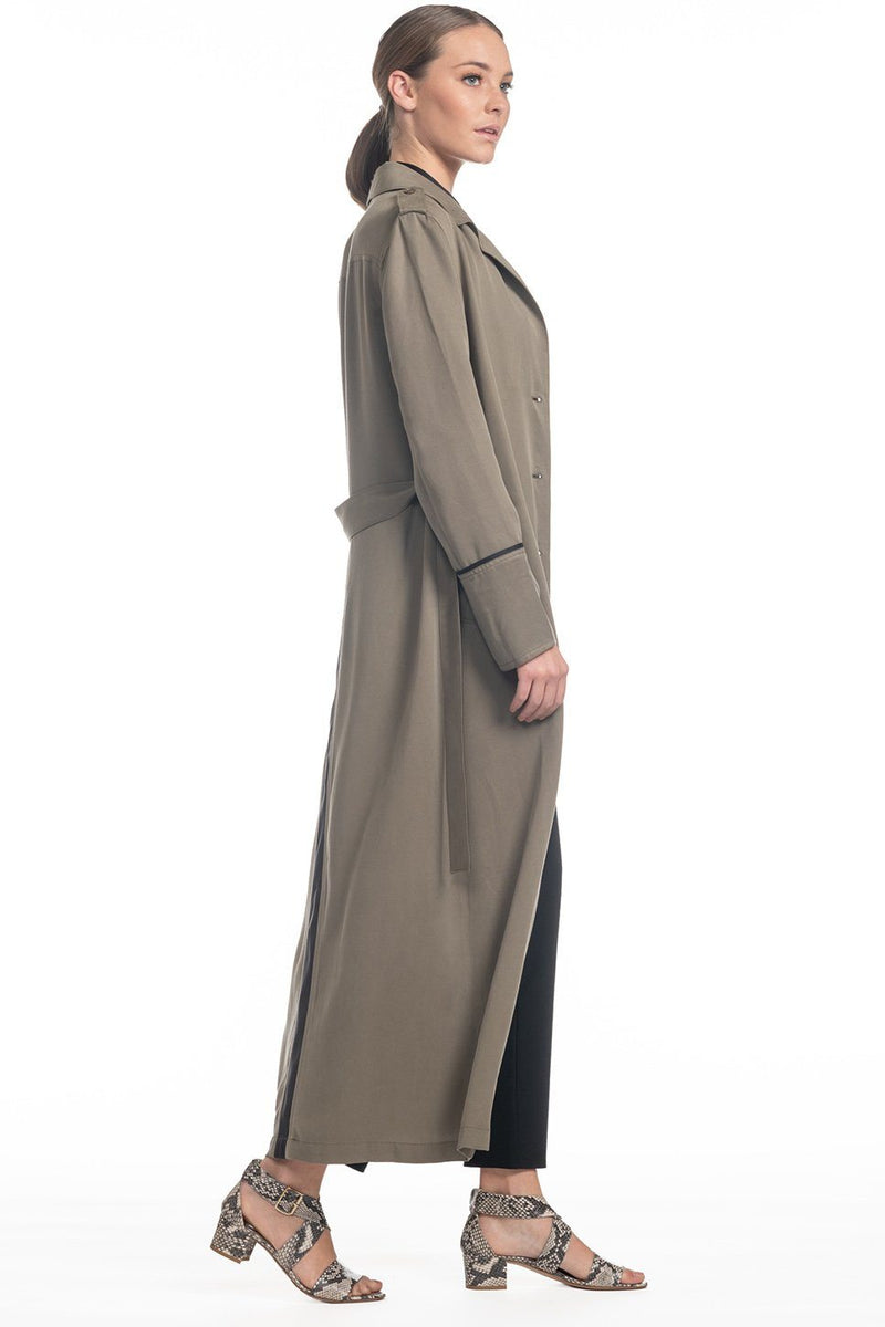 One model wearing a ladies lightweight trench coat in army on a white background.