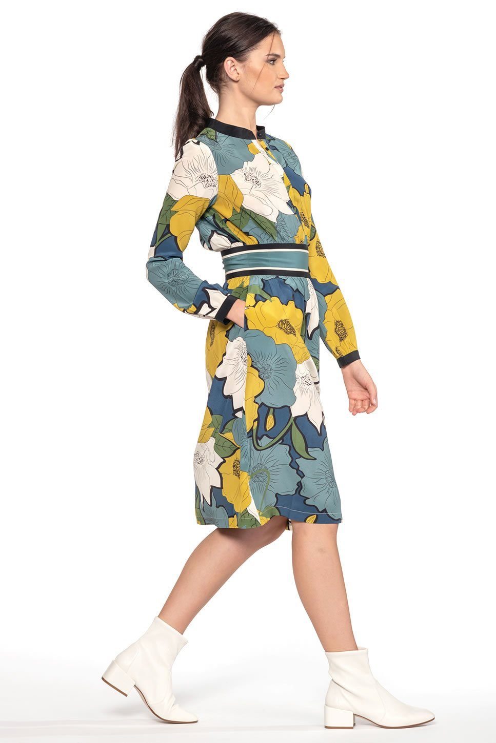 One model wearing a ladies midi, silk dress in La Jolla print on a white background.
