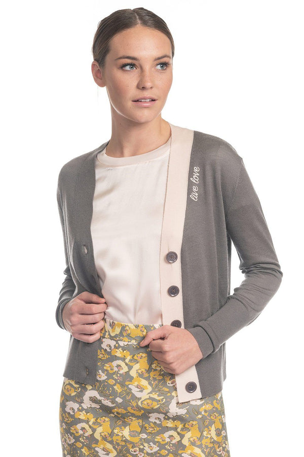 "One model wearing a ladies embroidered ""live love"" 100% cashmere v-neck cardigan in ash on a white background."