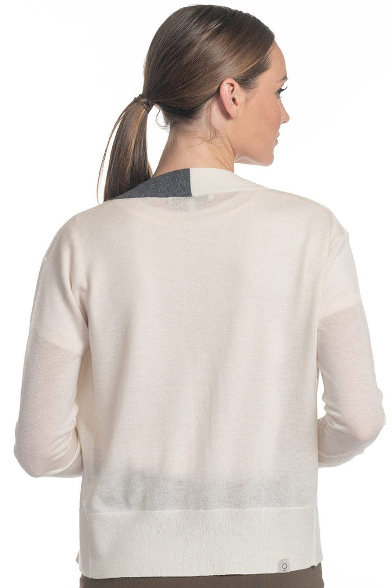 One model wearing a ladies 100% cashmere v-neck cardigan in ivory on a white background.