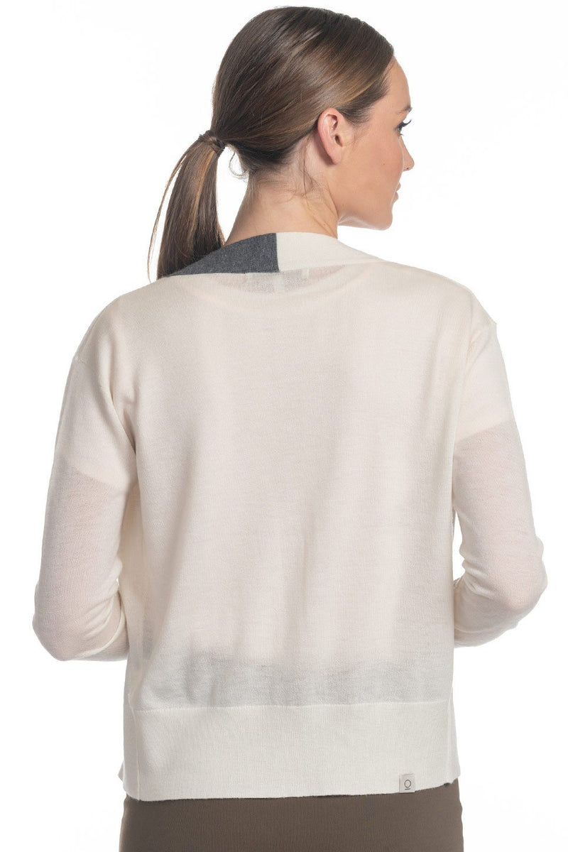 "One model wearing a ladies embroidered ""live love"" 100% cashmere v-neck cardigan in ivory on a white background."