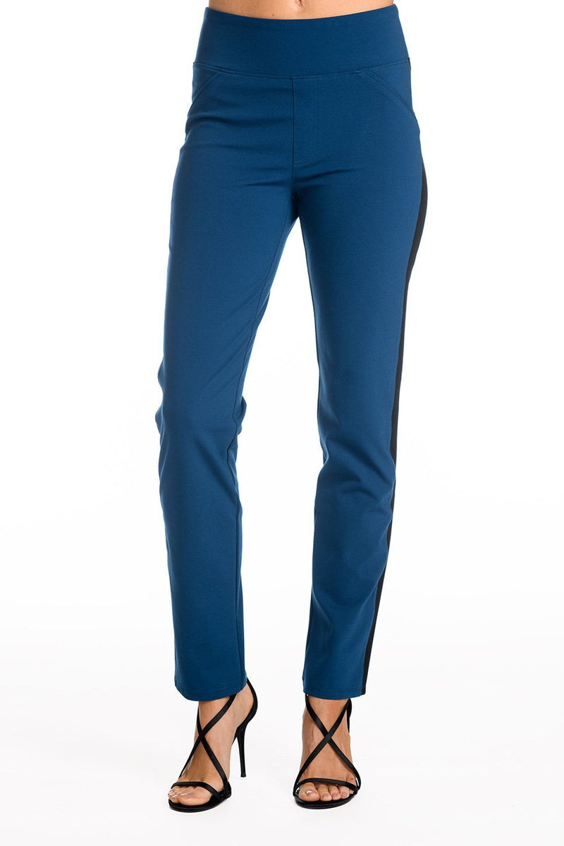 91d043a9a33 One model wearing a ladies technical stretch tuxedo pant for long legs in  azure with a