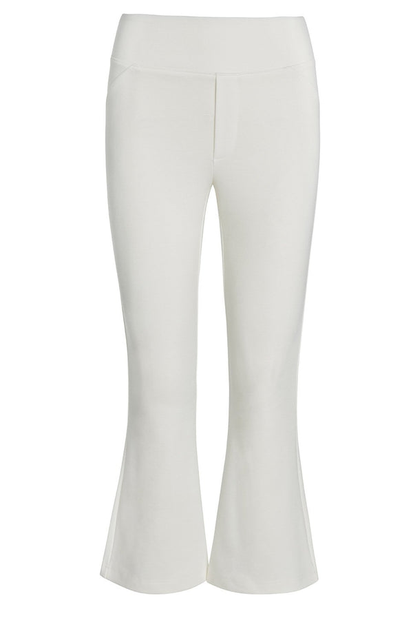 A ladies flared and cropped technical stretch pant in ivory on a white background.