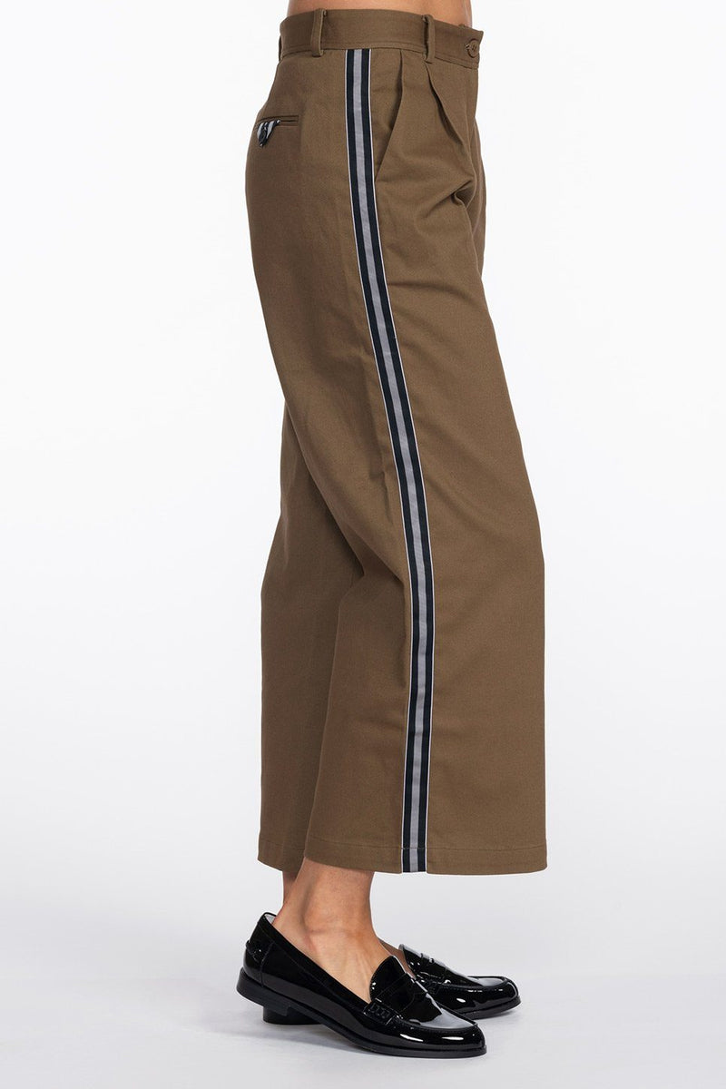One model wearing a ladies flared and cropped cotton pant in army with side stripe and back pocket ribbon detailing.
