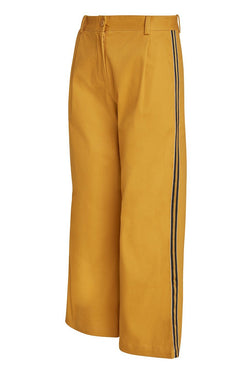 A ladies flared and cropped cotton pant in curry with side stripe and back pocket ribbon detailing.