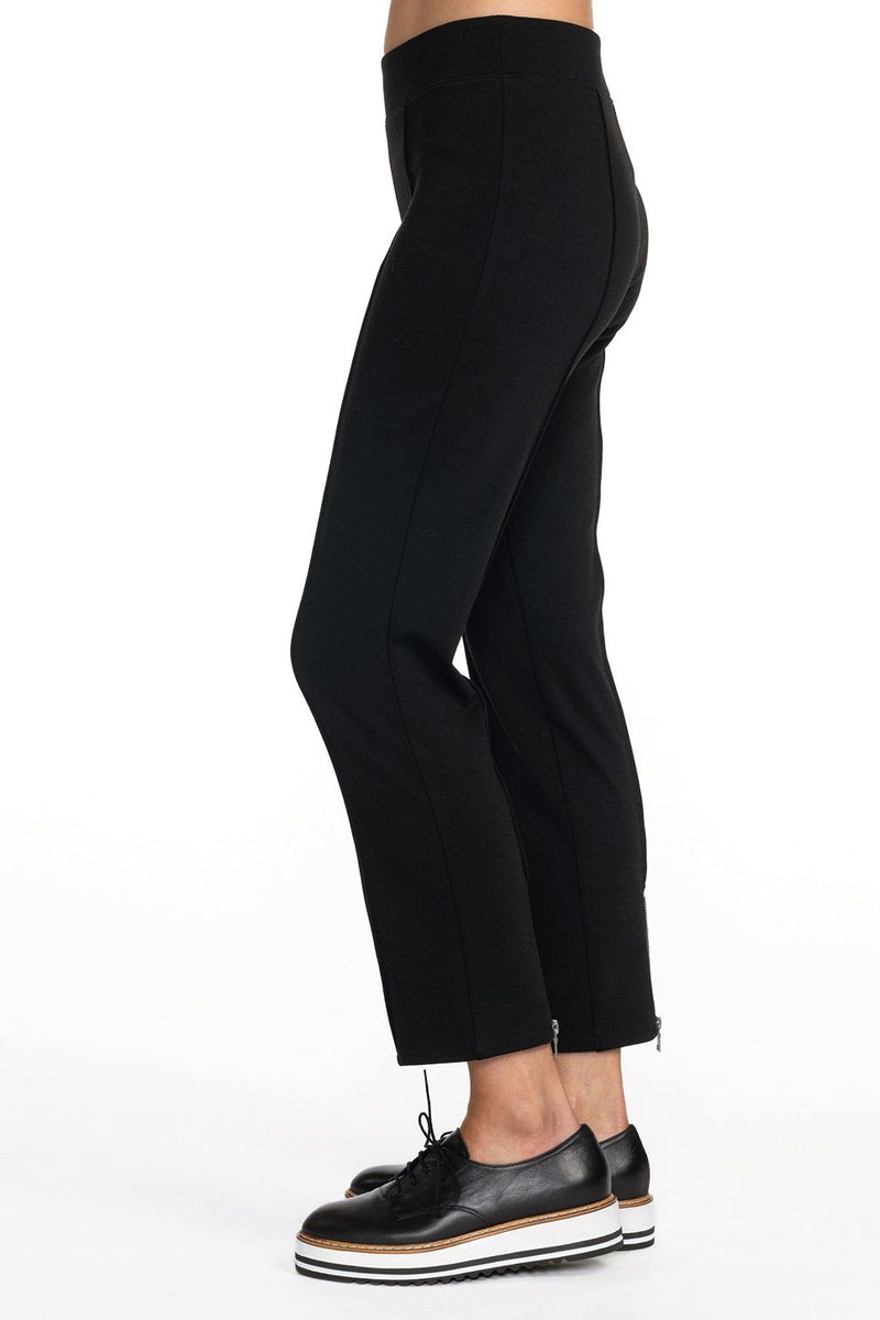One model wearing a ladies stretch ponte flare crop pant in black on a white background.
