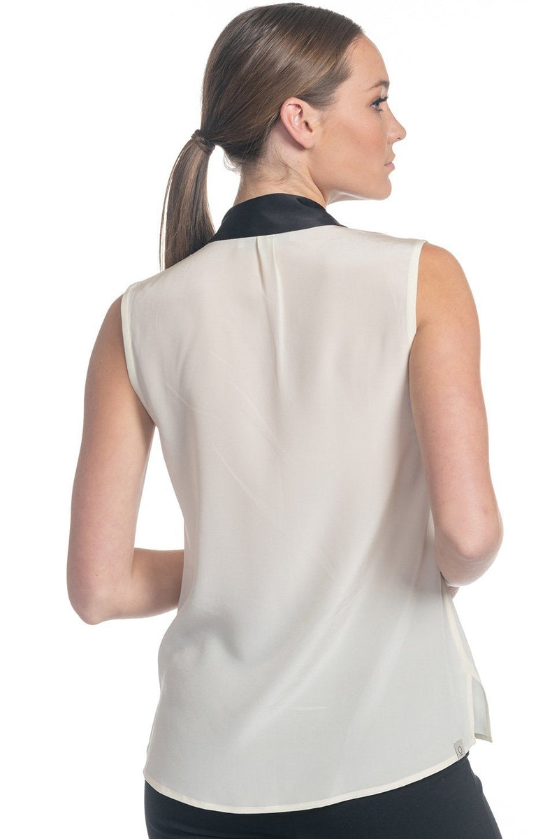 One model wearing a ladies tie neck silk shell in cloud on a white background.