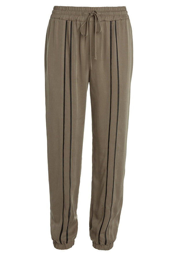 A ladies dressy track pant in army on a white background.