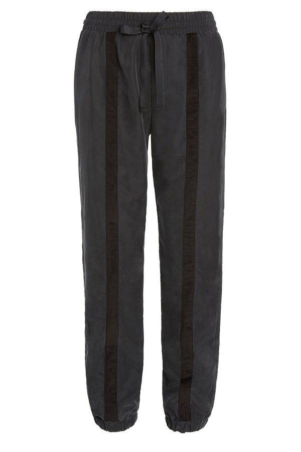 A ladies dressy track pant in charcoal on a white background.