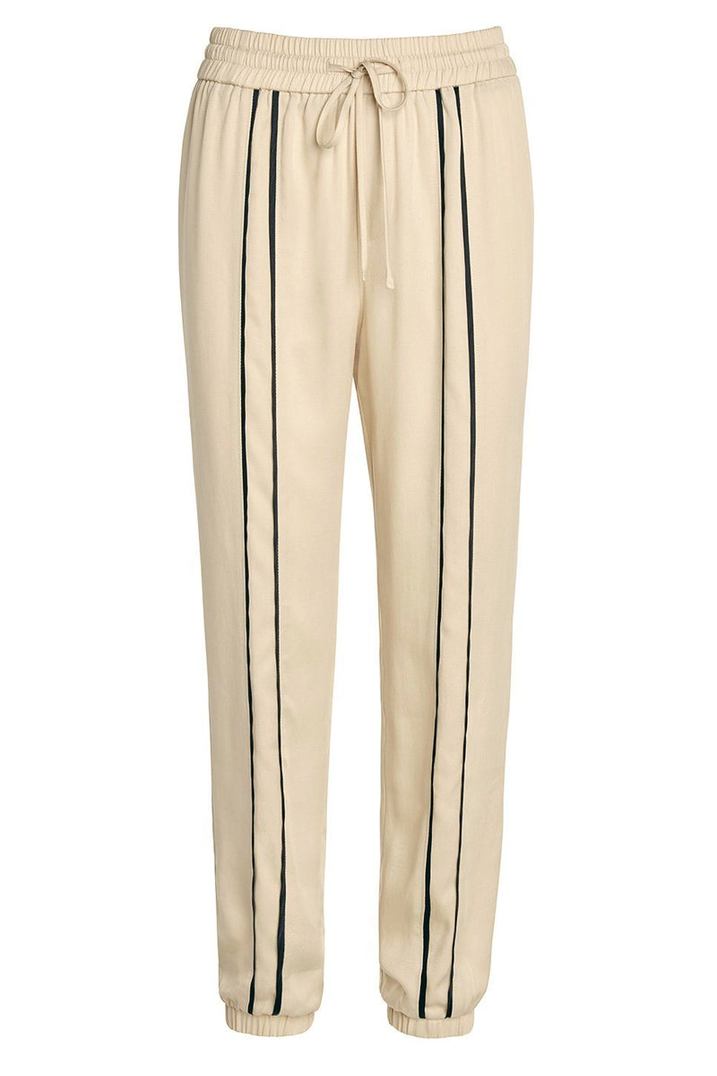 A ladies dressy track pant in latte on a white background.