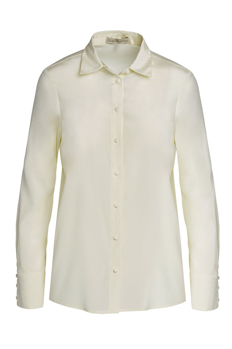 A ladies button down blouse in cloud on a white background.