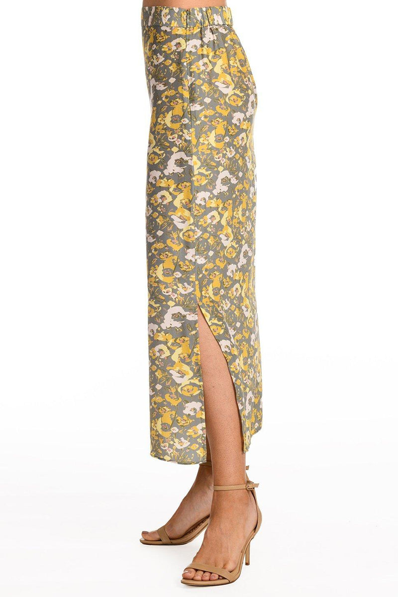 One model wearing a ladies flared midi slip skirt in slate floral on a white background.