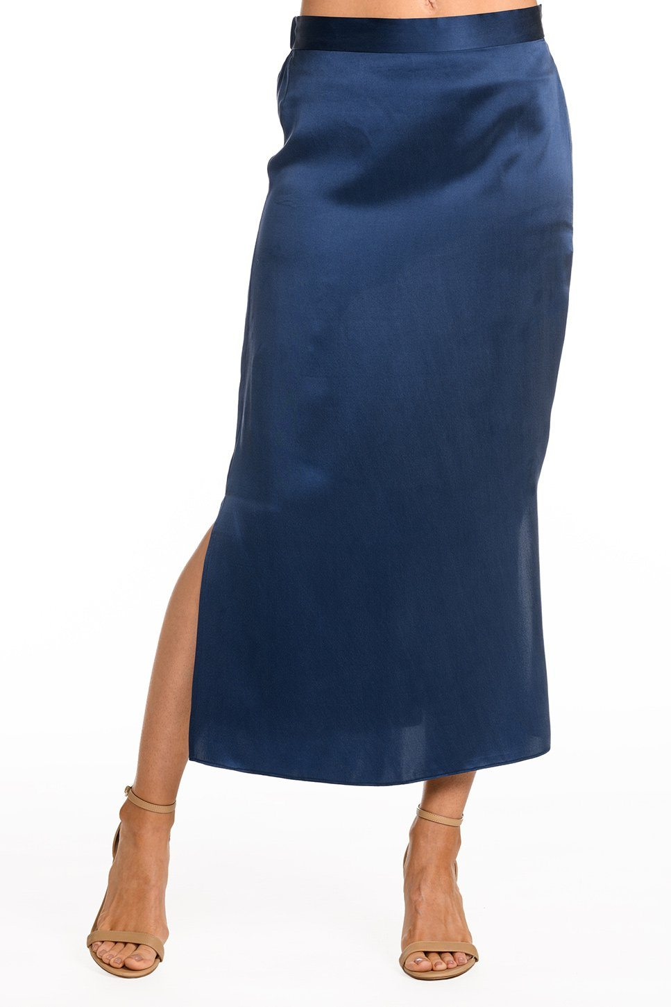 One model wearing a ladies flared midi slip skirt in navy on a white background.