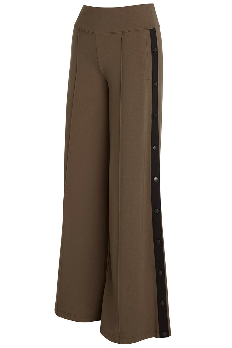 A ladies technical stretch, wide-leg pant in army with side snaps on a black stripe on a white background.