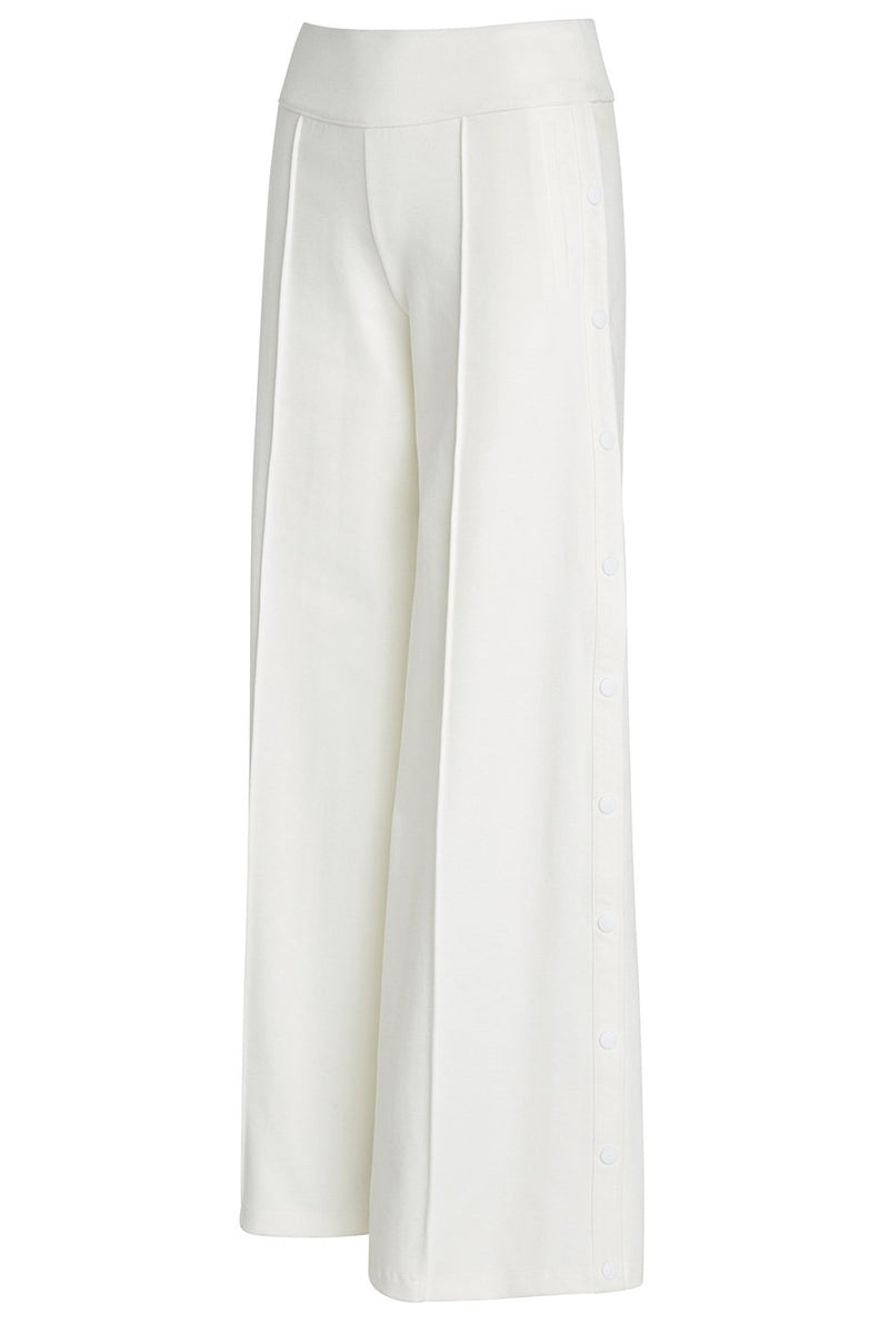 A ladies technical stretch, wide-leg pant with side snaps in ivory on a white background.