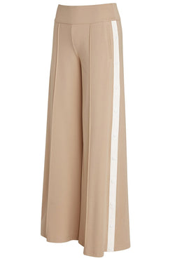 A ladies technical stretch, wide-leg pant in tan with side snaps on a white stripe on a white background.