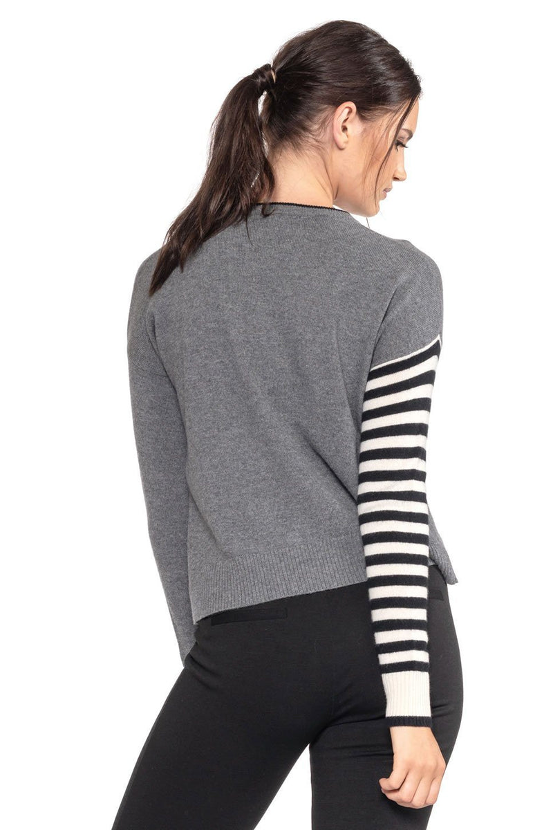 One model wearing a ladies striped 100% cashmere crew neck sweater in grey on a white background.