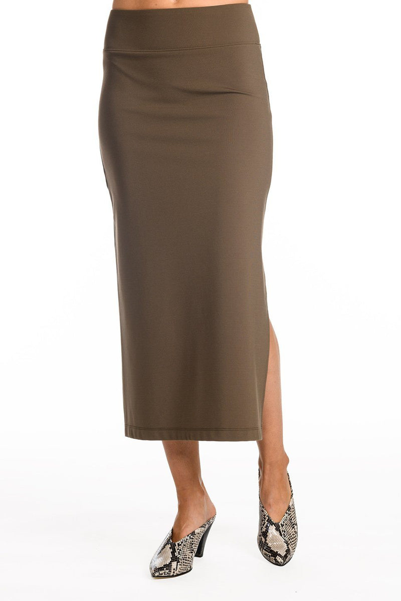 One model wearing a ladies technical stretch pencil skirt with side slit in army on a white background.