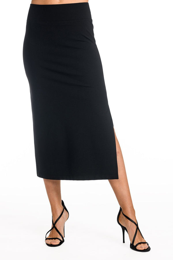 One model wearing a ladies technical stretch pencil skirt with side slit in black on a white background.